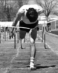 Tom Clark Completes a Hurdles Event by John Foster and Central Washington University